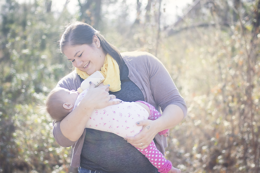 I asked Stephanie to document me giving Nora a bottle as a part of our journey together. Even though our breastfeeding journey had officially come to an end, I wanted to be able to look back and remember that feeding Nora was special, no matter how it was done. - photo credit  Stephanie Layne Photo