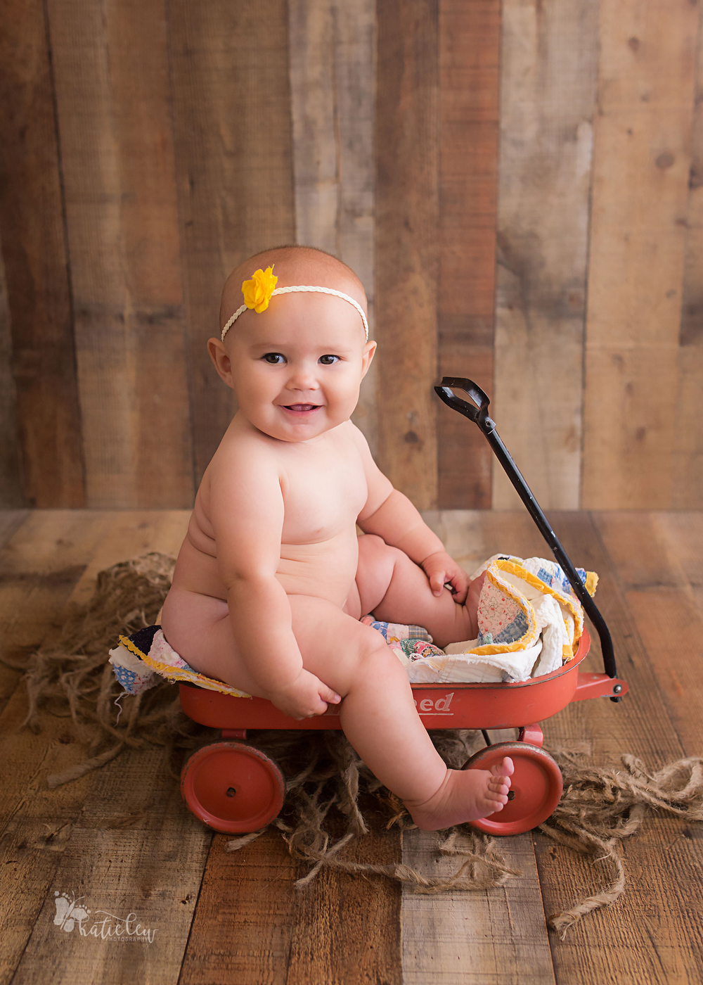 six month old baby girl in a cute wagon