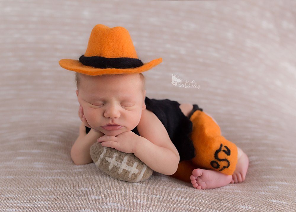 A baby boy dressed in Pistol Pete for his newborn photos.