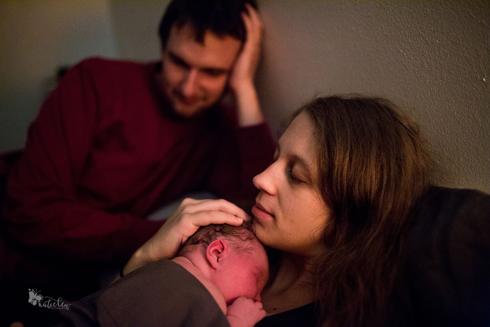 mother winding down with her freshly born baby after an intense homebirth in stillwater