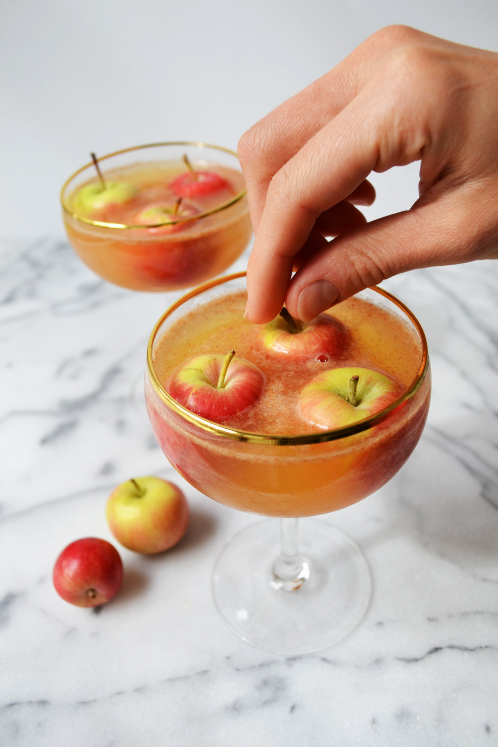 Bobbing for Apples   1.5 oz Bulleit Bourbon 1.5 oz apple juice ¼ oz simple syrup ¼ oz fresh lemon juice 1 pinch of cinnamon 3 tiny apples to garnish