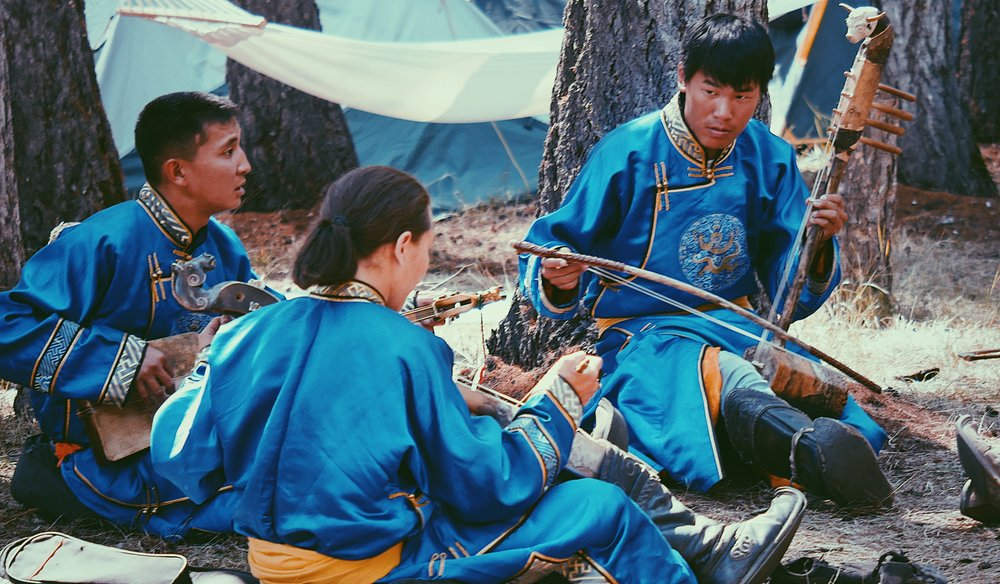 Tuvan throat singers rehearsing before the annual Ustuu Huree festival in Chadan, Republic of Tuva, Russia. The three traditional instruments in the photo are Doshpuluur, Igil and Byzaanchy from left to right.