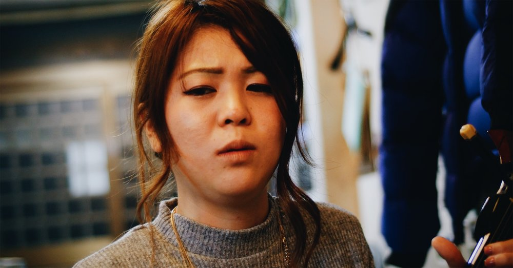Alice Sato is a Shimauta musician who sings and plays sanshin in Amami Oshima, Japan.