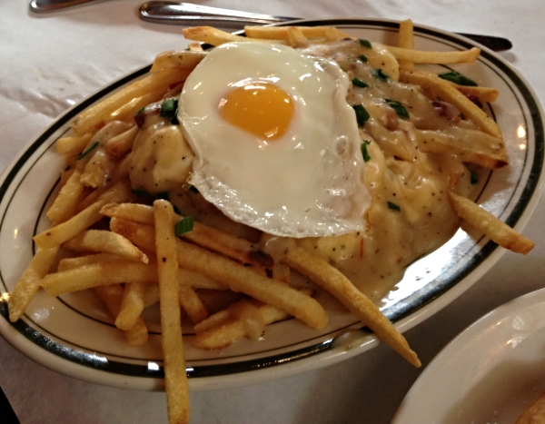 The poutine: Beglian fries, gravy, pork belly, cheese curds, and a fried egg.