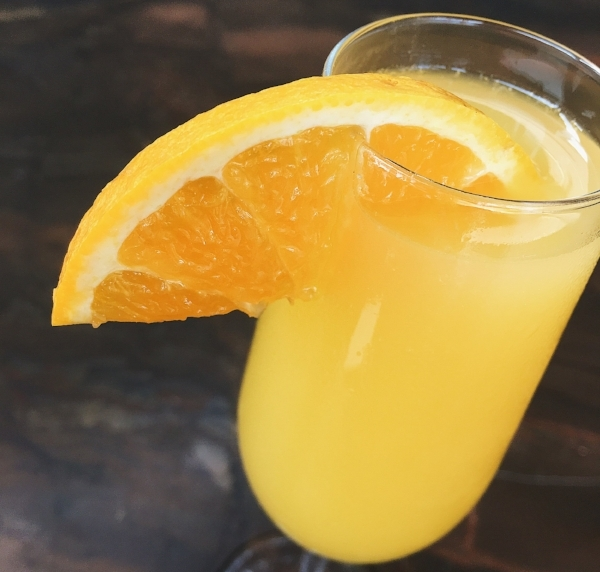 Sedona Taphouse  is keeping it classic with orange juice and champagne, garnished with an orange slice.