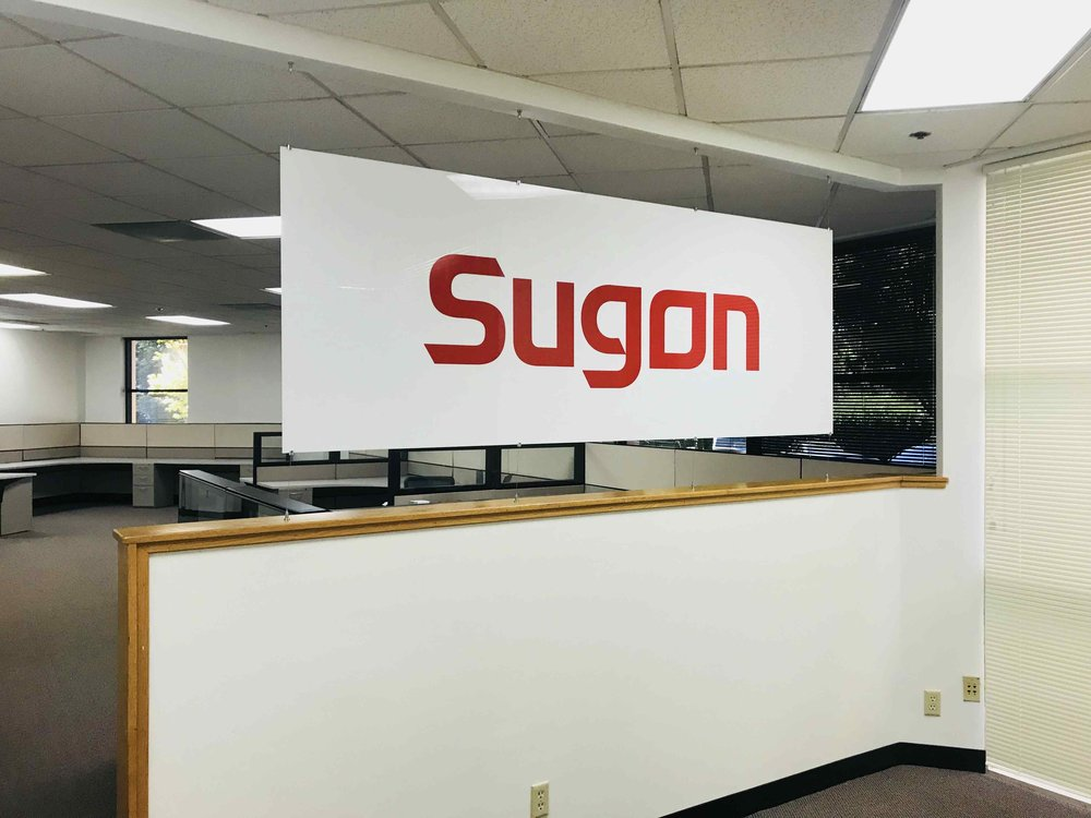 Cable-&-Rod-Display-Systems-Acrylic-Vinyl-Lobby-Sign.jpg