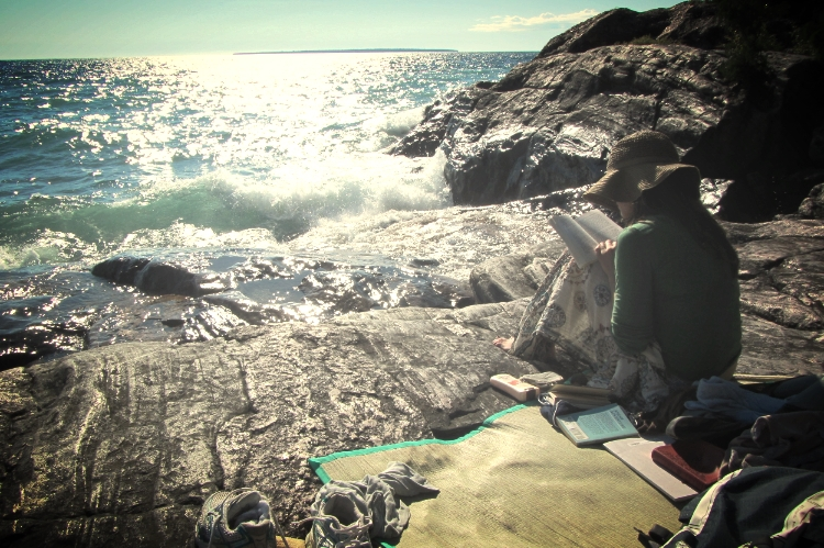 Corri's fave thing in the world might just be . . . reading by the water! (Lake Superior Provincial Park, Wawa, Ontario, Canada)