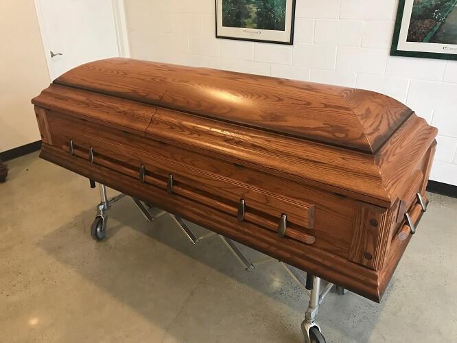 Rental Casket   Oak exterior, ivory crepe interior  $400.00