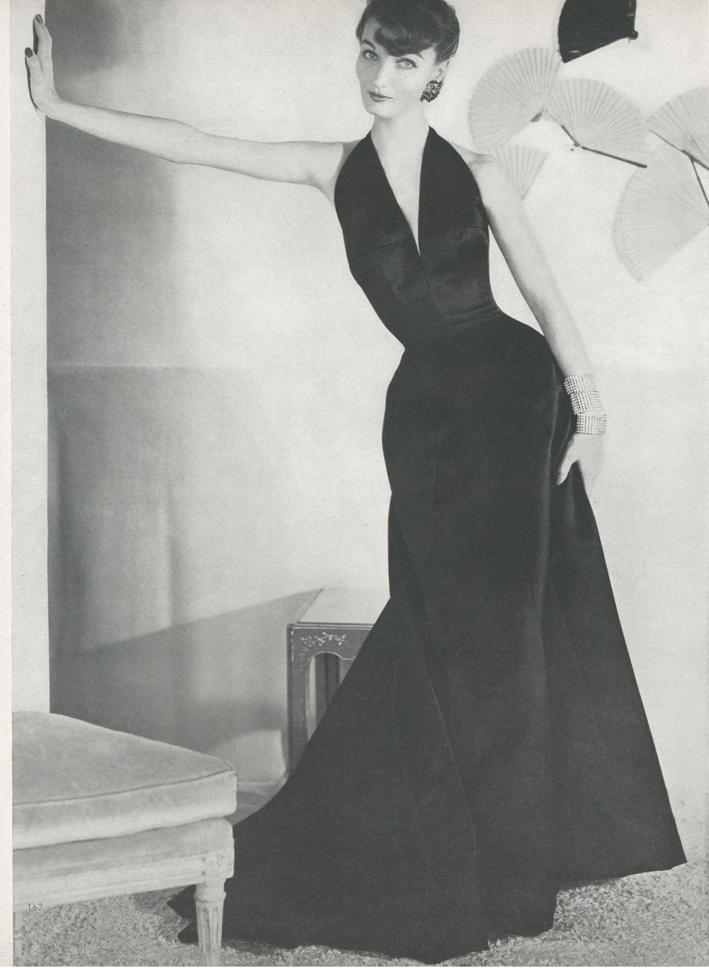 Galanos' first appearance in Vogue—a sculpted silk satin halter evening dress. Photographed by Horst P. Horst for Vogue, September 1953.