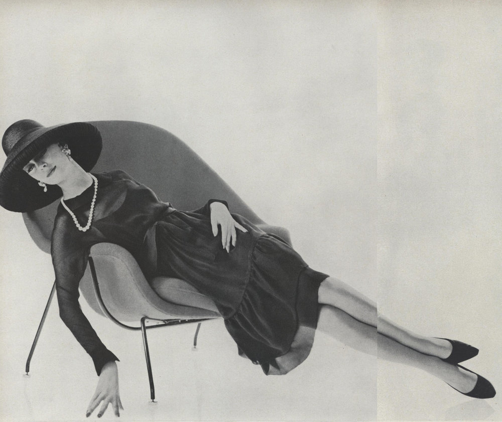 James Galanos believed that black was the most flattering color for all women and he always included several variations on the LBD in each collection. Long-sleeved black chiffon dress with a navy flounce, over a navy slip; the matching hat is navy blue rolled in black chiffon. Photographed by Karen Radkai for  Vogue , February 1962.