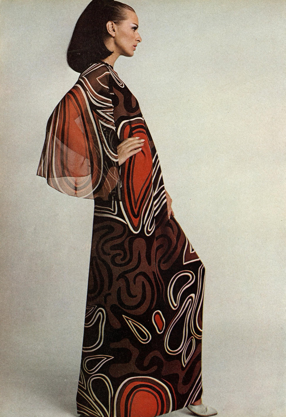 "A ""wing-sleeved pyramid for evening"" made of chiffon with a textile design by Tzaims Luksus. Photographed by Francesco Scavullo for  Harper's Bazaar , April 1966."
