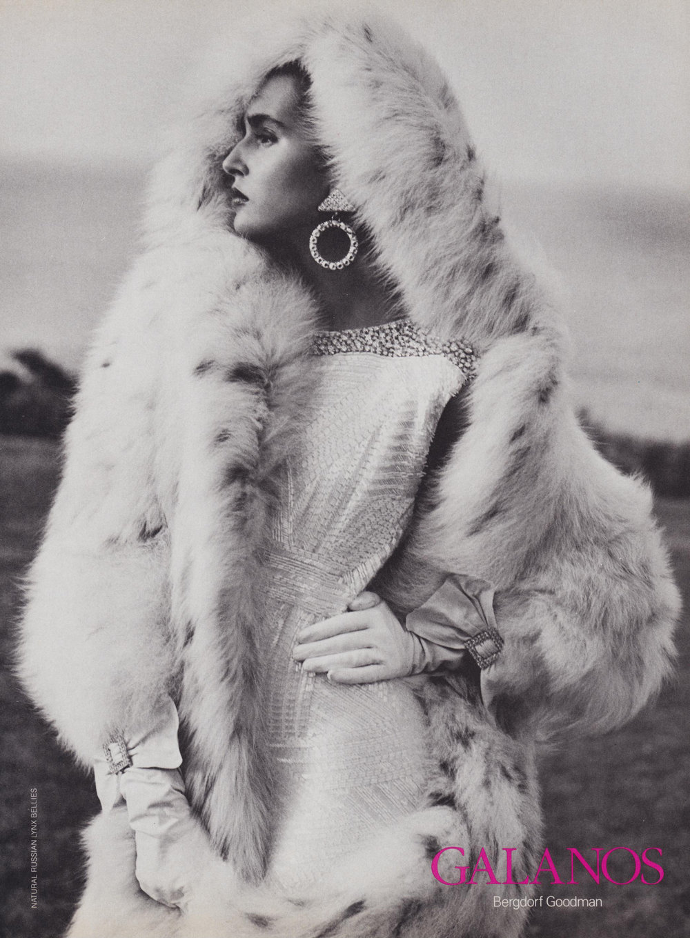 An ad for Galanos at Bergdorf Goodman, featuring his fully beaded white evening dress and lynx coat for A/W 1985.