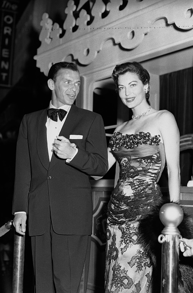 Frank Sinatra escorts a lace clad Ava Gardner to the  Show Boat  premiere in Hollywood, September 18, 1951.