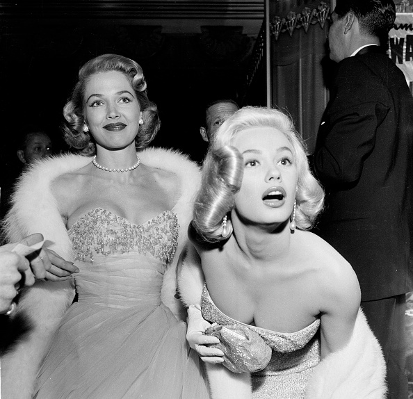 Glamour girls Sara Shane and Mamie Van Doren attending the premiere of  The Glenn Miller Story  in Los Angeles, December 10, 1953.