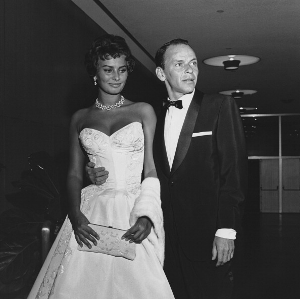Frank Sinatra getting close to the immaculate Sophia Loren at the Hollywood premiere of  The Pride And The Passion  on June 26, 1957.