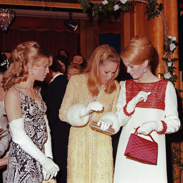 Goddesses Julie Christie, Ursula Andress and Catherine Deneuve showing how it is done at a Royal Film Performance of  Born Free  in London on 14th March 1966.