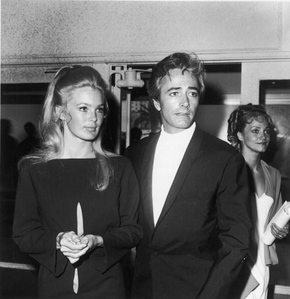 In a simple black shift and perfect blond hair, Linda Evans attends the Emmy Awards with husband John Derek, May 1968.