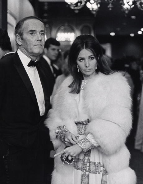 Wearing a heavily beaded white gown with a white fox fur coat, Shirlee Fonda accompanies her husband Henry to the New York premiere of his film,  The Lion in Winter,  on October 30, 1968.