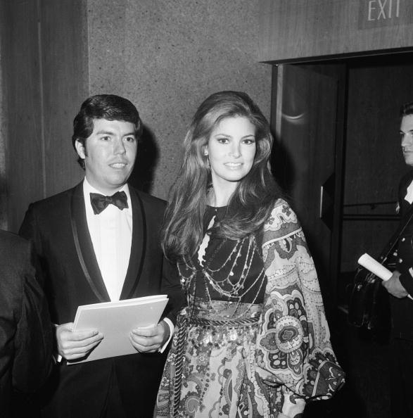 Layering a body chain over a psychedelic print dress, Raquel Welch attends the Academy Awards in Los Angeles on April 14, 1969.