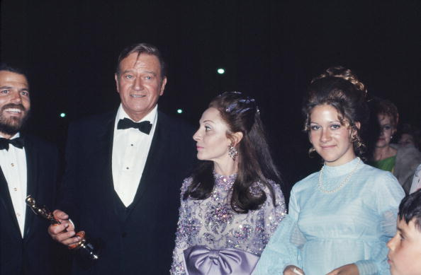 John Wayne with his sparkling lavender wife, Pilar, and daughter at the Academy Awards after winning the best actor Oscar for  True Grit  on April 7, 1970 in Los Angeles.