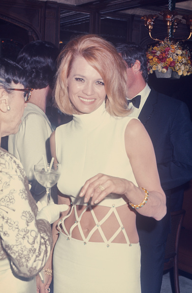Angie Dickinson in a white bare midriff dress by Bob Mackie at an event in New York in 1970; she also wore this dress to the Academy Awards.