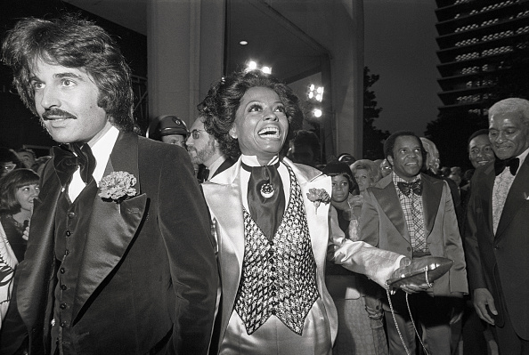 Arriving in a white satin three-piece suit, Diana Ross enters the 45th annual Academy Awards ceremony on March 27, 1973.