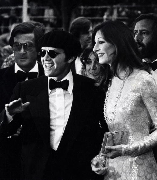 Anjelica Huston, in a Halston fishscale sequin dress, with boyfriend Jack Nicholson arriving at the 47th Annual Academy Awards on April 8, 1975.