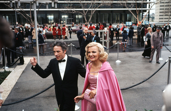 In the ultimate Barbie outfit, Gena Rowlands arrives with her husband John Cassavetes to the 47th Academy Awards in 1975.