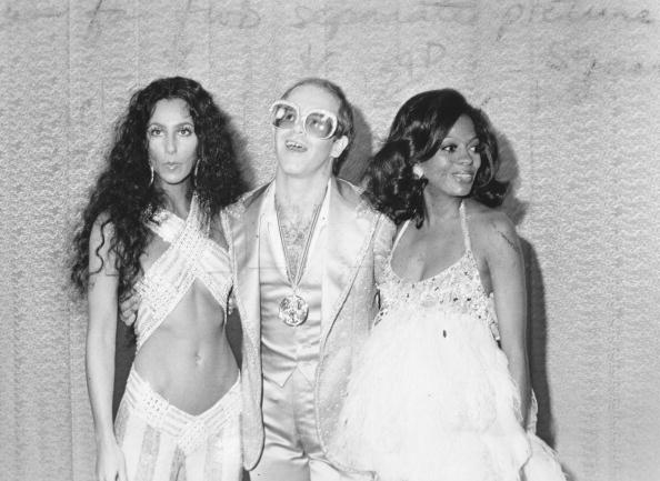 An explosion of sparkles and satin with Cher, Elton John and Diana Ross backstage at the 1975 Rock Music Awards.