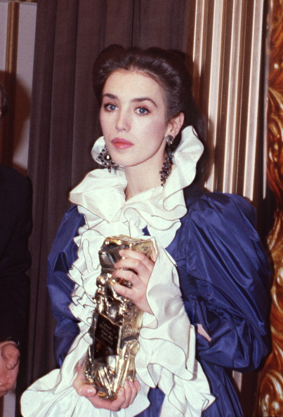Isabelle Adjani poses in a cloud of silk ruffles with her Cesar award on February 27, 1982 in Paris.