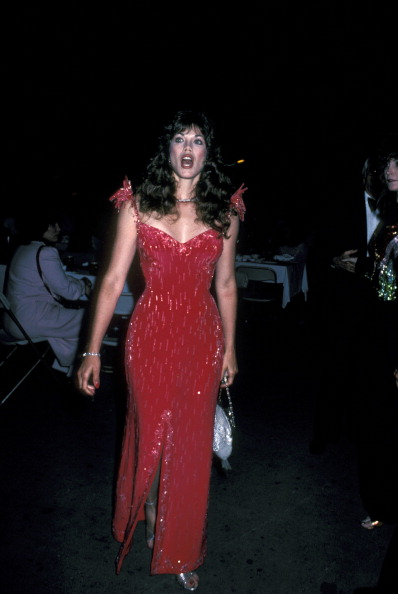 A proto-Jessica Rabbit in skintight red beading, Barbi Benton attending the 11th Annual Alan King And Caesars Palace Tennis Classic Pro-Celebrity Party And Draw at Caesar's Palace in Las Vegas on April 23, 1982.