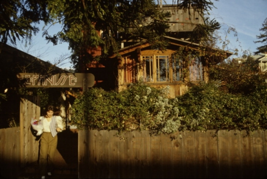 Alice Waters outside of Chez Panisse in Berkeley, California. Photo by Susan Wood, 1982.