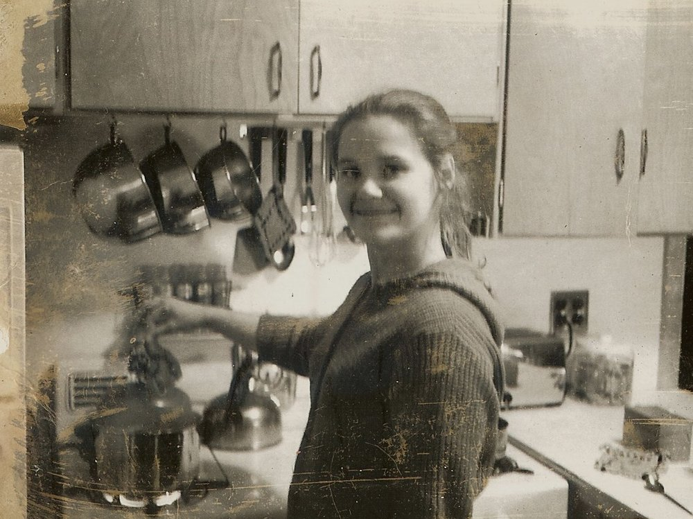 Marian trying a recipe from Julia Child in 1963.