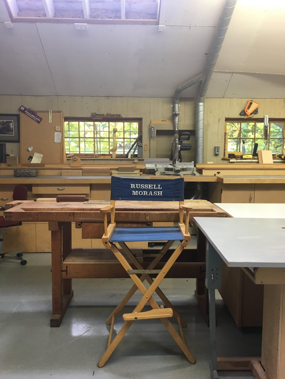 Russell Morash's director's chair with Norm Abrams' nameplate above the window. (Photo by author).