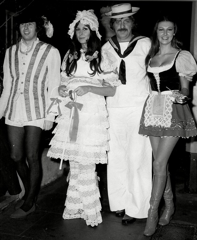 Victor Lownes and Marilyn Cole (both to the right) with another couple at a fancy dress party in 1971.