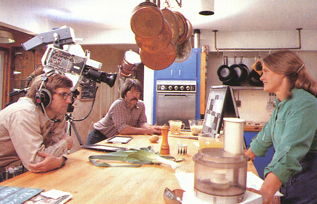 Filming the vegetable recipe segment of 'The Victory Garden' in her own kitchen. From 'The Victory Garden Cookbook', 1982.