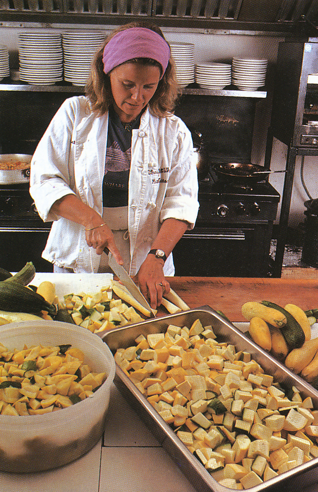 Marian preparing squash in the Straight Wharf kitchen. From 'The Victory Garden Cookbook', 1982.