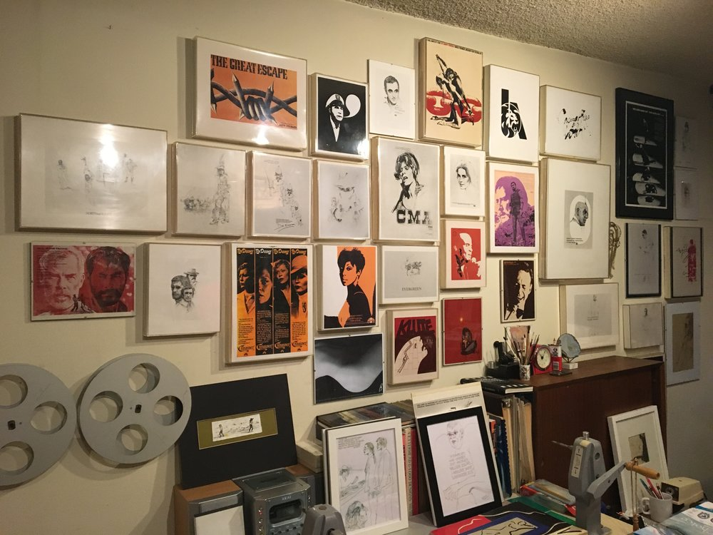 His artwork also paper the walls in his studio.