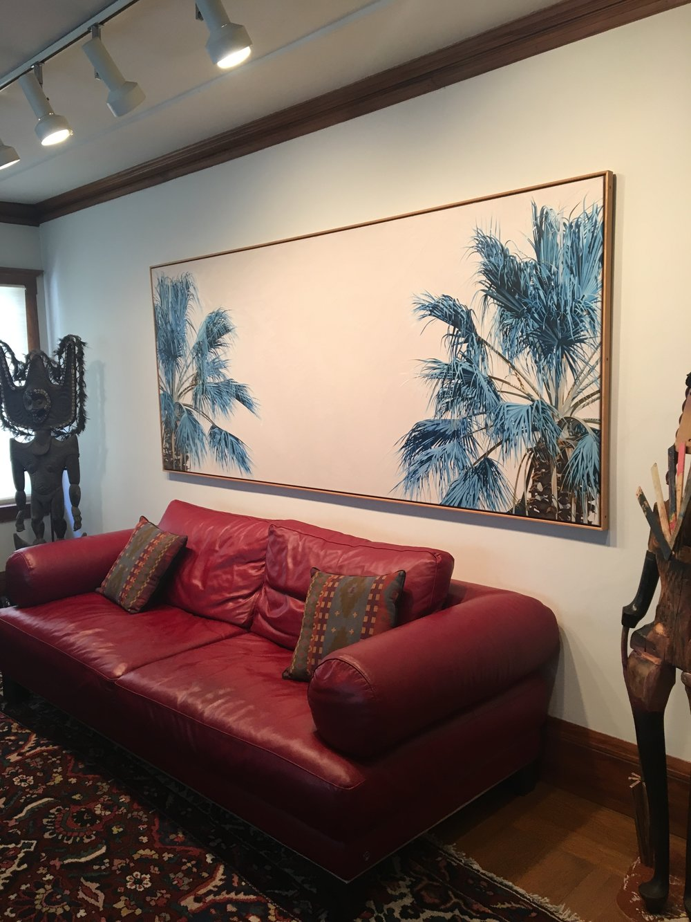 "Mel's painting, ""Four Seasons: Winter"" (1983), in his living room."