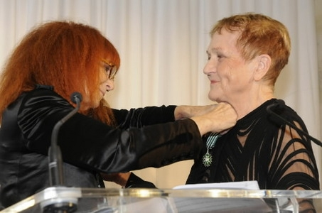 Sonia Rykiel pinning the Chevalier of the Order of Arts and Letters onto Marylou in a ceremony in Paris in 2008.
