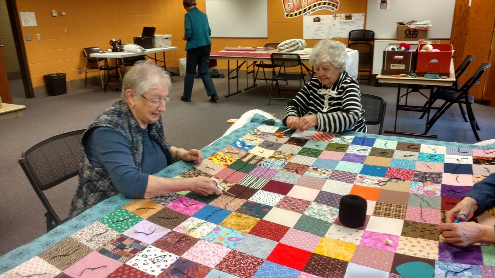 Quilters work dilligently every Tuesday making quilts for charity
