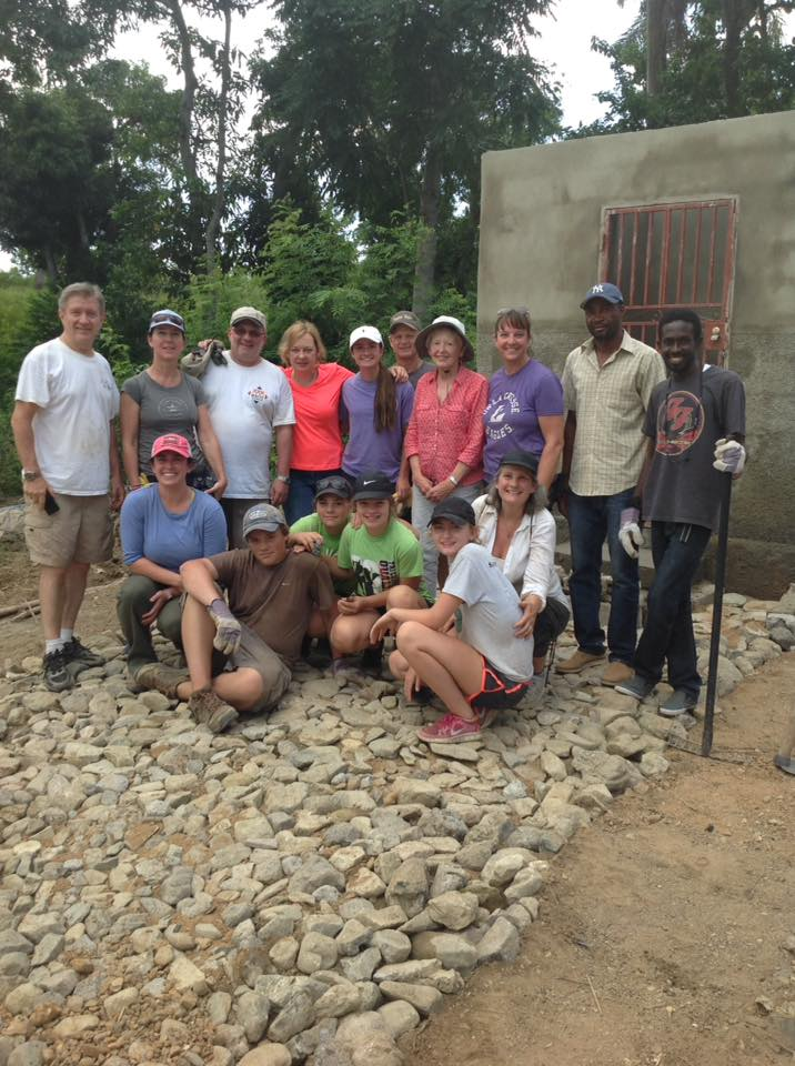 Group photo in front of unfinished well.jpg