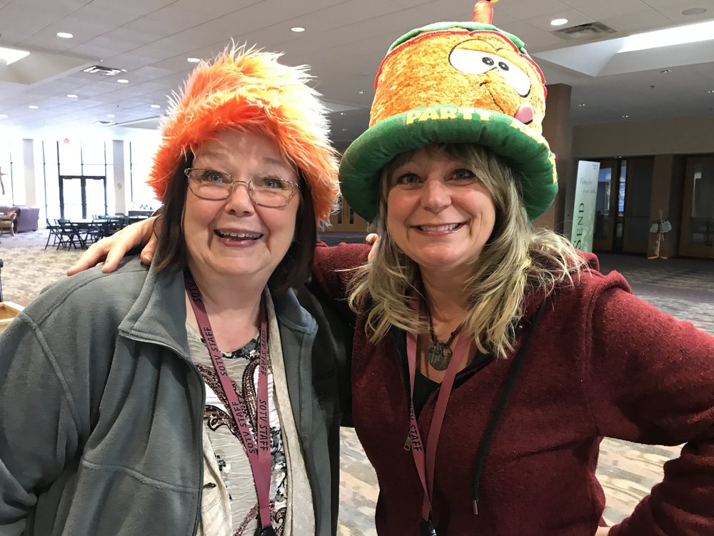 Sam Heiting & Lisa Hegerman showing their wacky hats.
