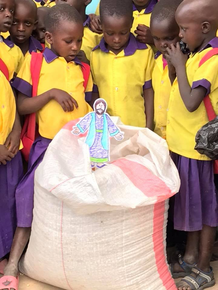 Tanzania children with flat Jesus.jpg