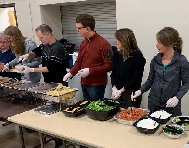 SOTV Confirmation Guides ready to serve dinner January 9, 2019 at the Dakota County Emergency Shelter. Picture by Mike Pahl.