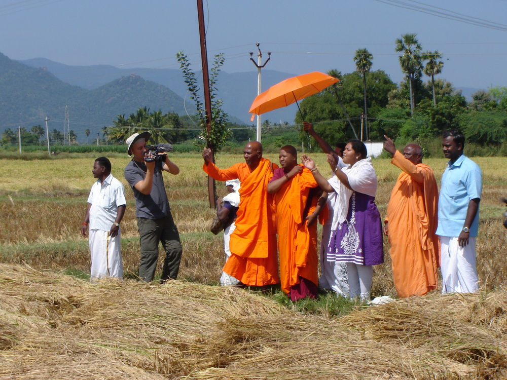 Filming monks and nuns blessing the Untouchable farm workers, Tamil Nadu, India