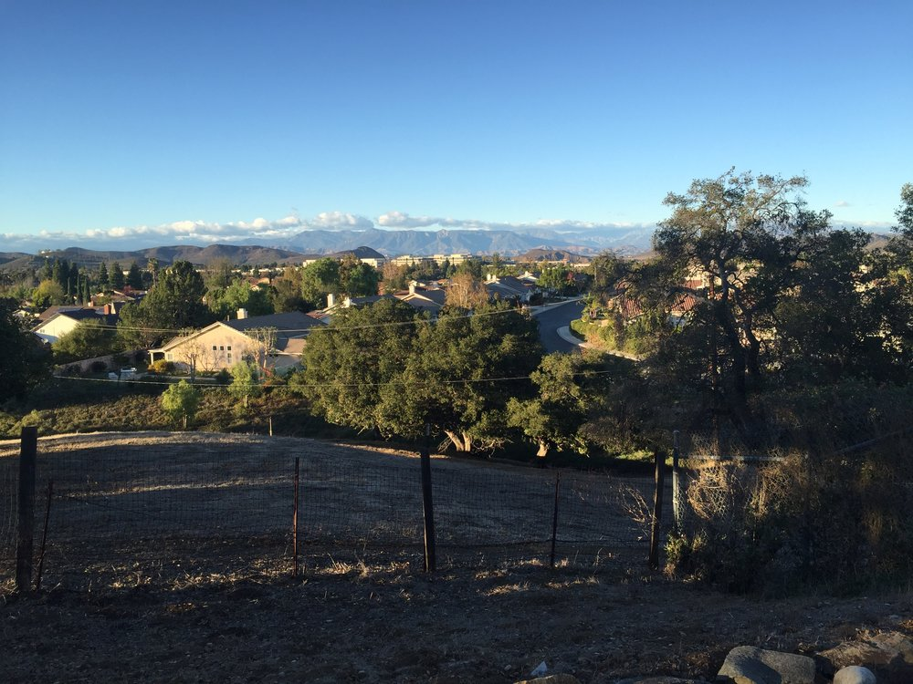 FINAL SUPERIOR DEVELOPMENT OPPORTUNITY IN THOUSAND OAKS  1617 SUSAN DR, THOUSAND OAKS, CA 91320   $4,400,000                                       Unending bright skies of blue and pink bathe the landscape in warm glow here at Thousand Oaks last superior development opportunity. 5 Acres of flat land and rolling hills with a main entranceway conveniently located on Lynn Rd highway. Currently zoned residential, one house per acre and utility-ready. A single family home with pool resides at the Blair Ct. entranceway ready for remodel or demolition.  Additional structures include corral, trough and a she-shed with a covered porch.