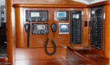 nav station in boat with wood paneling