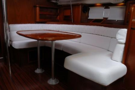 on boat booth table with white cushioned seating