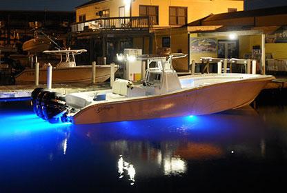 docked speed boat with blue led lights